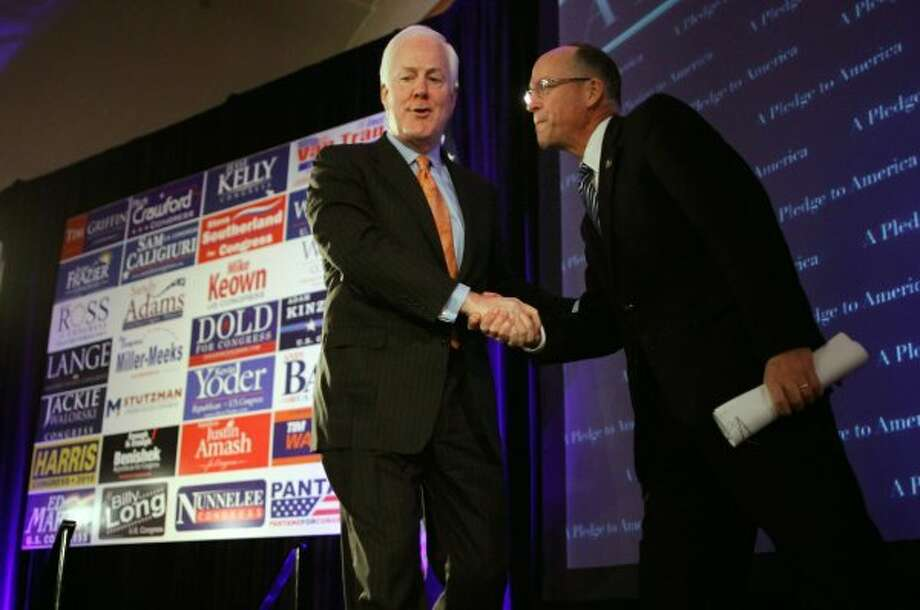 Rep. Greg Walden, R-Ore., welcomes Sen. John Cornyn to the stage during the Republican National Congressional Committee's midterm election results watch party at the Grand Hyatt hotel Nov. 2, 2010 in Washington, DC. (Chip Somodevilla / Getty Images)
