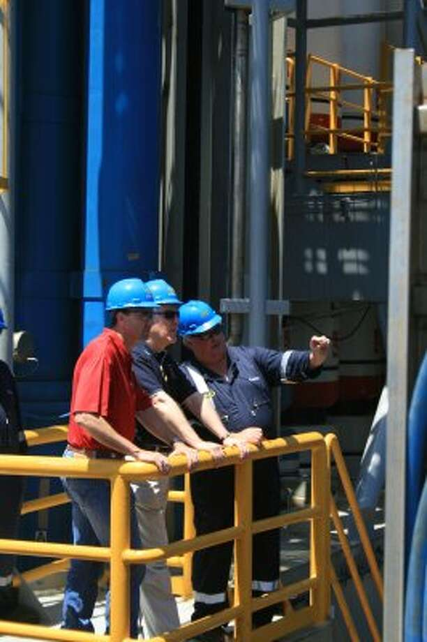 Rep. Pete Olson and Sen. John Cornyn listen to Noble Corp.'s Tommy Travis discuss blowout preventers aboard Noble's Danny Adkins rig in the Gulf of Mexico on July 6, 2010. (Loren Steffy / Houston Chronicle)