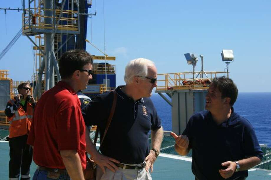 Rep. Pete Olson and Sen. John Cornyn talk with Noble Corp.'s John Breed aboard Noble's Danny Adkins drilling rig in the Gulf of Mexico on July 6, 2010. (Houston Chronicle)