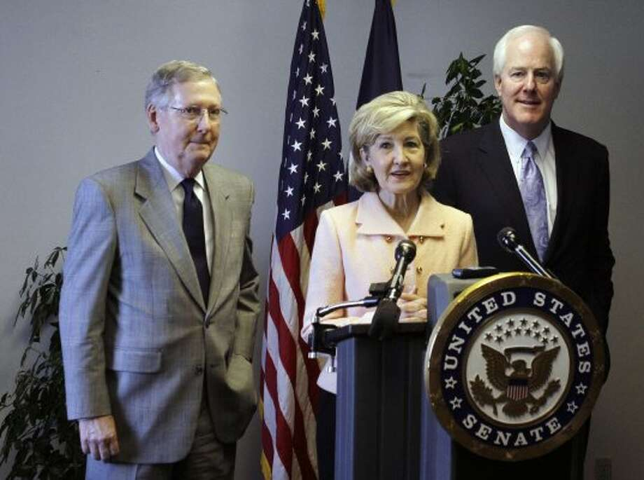 Flanked by Sen. John Cornyn and Republican leader Mitch McConnell, Sen. Kay Bailey Hutchison speaks during a news conference Wednesday March 31, 2010 in San Antonio. (JOE MITCHELL / The Associated Press)