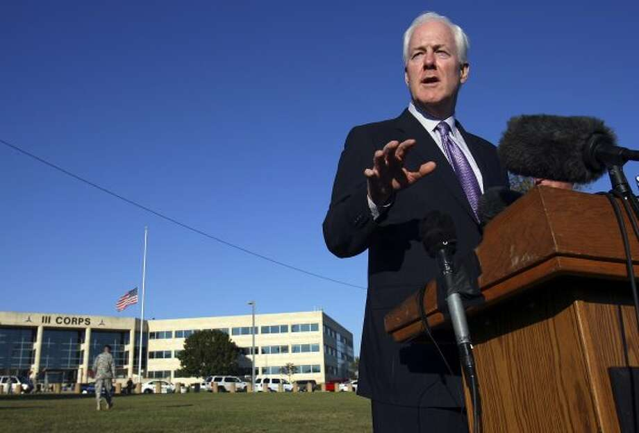Senator John Cornyn answers questions from the media outside III Corps headquarters Friday Nov. 6, 2009 on Fort Hood Army Base in Fort Hood, Tx. (Edward A. Ornelas / San Antonio Express-News)