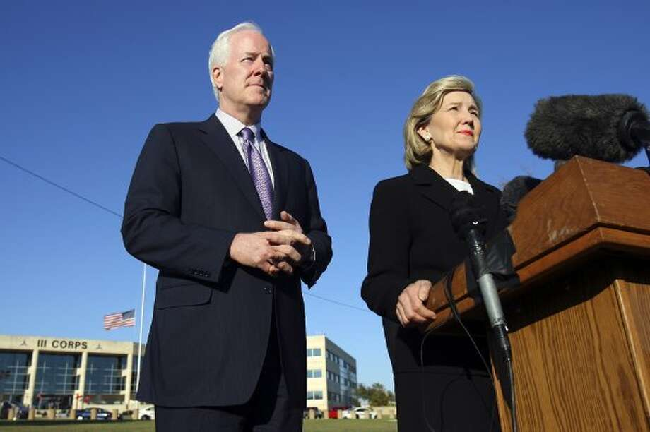 John Cornyn and Kay Bailey Hutchison speak during a press conference outside III Corps headquarters Friday Nov. 6, 2009 on Fort Hood Army Base in Fort Hood, Tx. (Edward A. Ornelas / San Antonio Express-News)