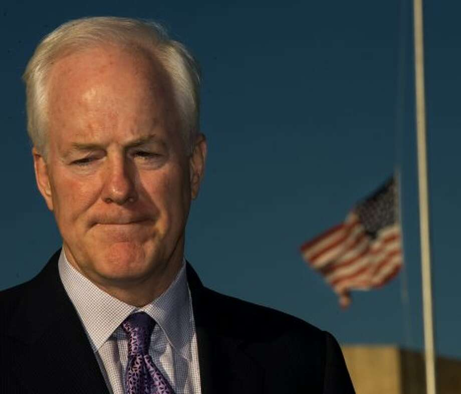 The US flag flies at half-staff as Senator John Cornyn delivers remarks on Nov. 6, 2009 outside US Army III Corps Headquarters one day after the shootings at Fort Hood in Texas. (Paul J. Richards / AFP/Getty Images)