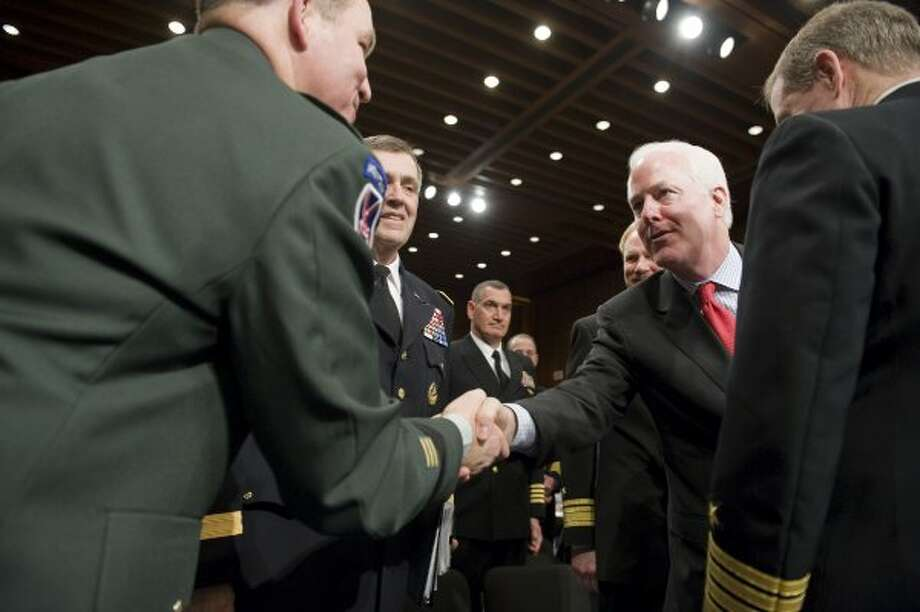 Senator John Cornyn greets US Army Lieutenant General Benjamin C. Freakley, Commanding General of the US Army Accessions Command, before a hearing on the incidence and prevention of military suicides by the Personnel Subcommittee of the Senate Armed Services Committee in Washington, March 18, 2009. (Jonathan Ernst / For the Chronicle)