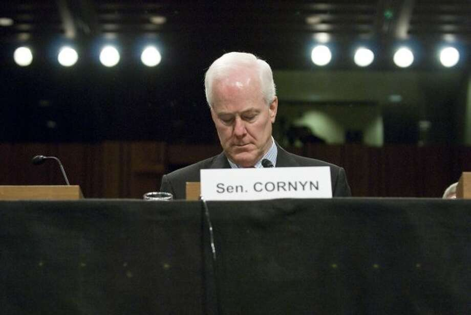 Sen. John Cornyn takes his seat for a hearing on the incidence and prevention of military suicides by the Personnel Subcommittee of the Senate Armed Services Committee in Washington on March 18, 2009. (Jonathan Ernst / For the Chronicle)