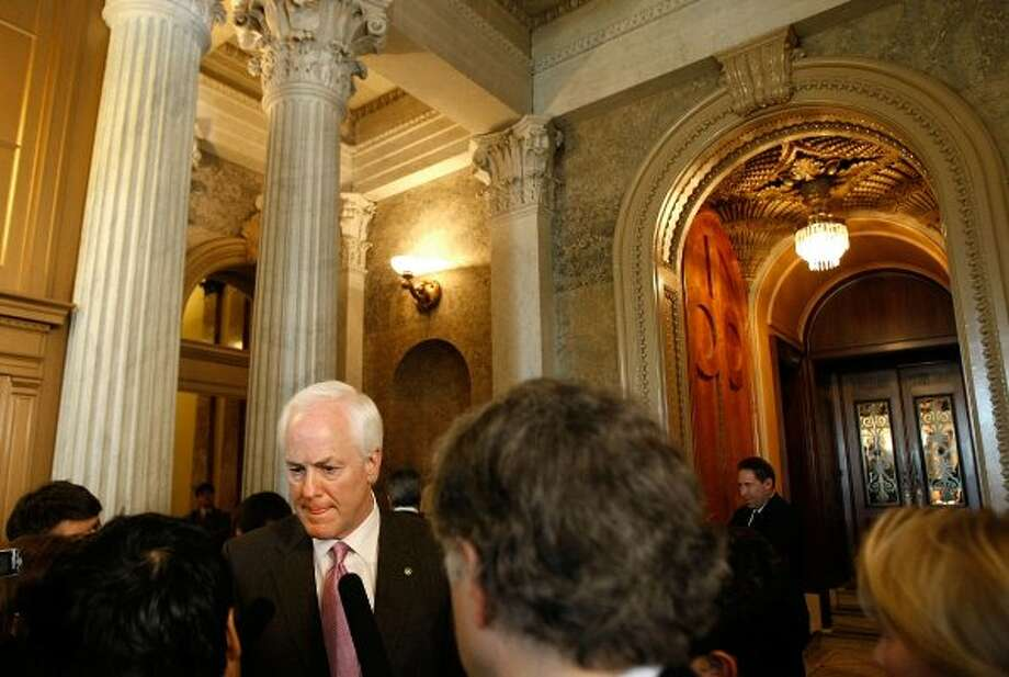 Sen. John Cornyn talks with reporters after a series of amendment votes on the economic stimulus legislation in the U.S. Capitol Feb. 6, 2009 in Washington, DC. (Chip Somodevilla / Getty Images)