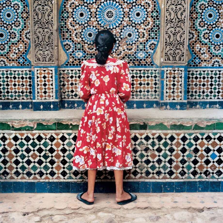 Yto Barrada Girl in Red, Tangier, from A Life Full of Holes: The Strait Project, Chromogenic print 23 5/8 x 23 5/8 inches 1999 International Center of Photography, Purchase, with funds provided by Anne and Joel Ehrenkranz, 2007 Galerie Polaris: ©Galerie Polaris