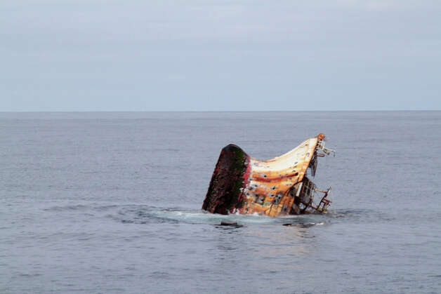 The rusted bottom of the Japanese fishing vessel Ryou-Un Maru is exposed as the vessel sinks in the Gulf of Alaska more than 180 miles southwest of Sitka, Alaska, April 5, 2012. The Coast Guard worked closely with federal, state and local agencies to assess the immediate dangers the vessel presented and determined that sinking the vessel at sea would be the best course of action to help minimize any navigation and environmental threats. Photo: Petty Officer 2nd Class Brandon Thomas / US COAST GUARD