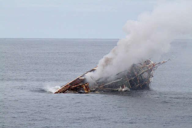 The Japanese fishing vessel Ryou-Un Maru sinks in the Gulf of Alaska after receiving significant damage from the Coast Guard Cutter Anancapa crew firing explosive ammunition into it 180 miles west of the Southeast Alaskan coast April 5, 2012. The crew was successful and sank the vessel at 6:15 p.m. in 6,000 feet of water by using explosive ammunition and filling it with water. Photo: Petty Officer 2nd Class Brandon Thomas / US COAST GUARD