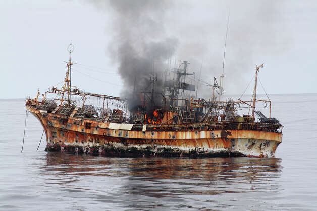 The Japanese fishing vessel Ryou-Un Maru begins to sink and list to starboard after receiving significant damage from the Coast Guard Cutter Anancapa crew firing explosive ammunition into it 180 miles west of the Southeast Alaskan coast April 5, 2012. The derelict fishing vessel sank at 6:15 p.m. in 6,000 feet of water. Photo: Petty Officer 2nd Class Brandon Thomas / US COAST GUARD