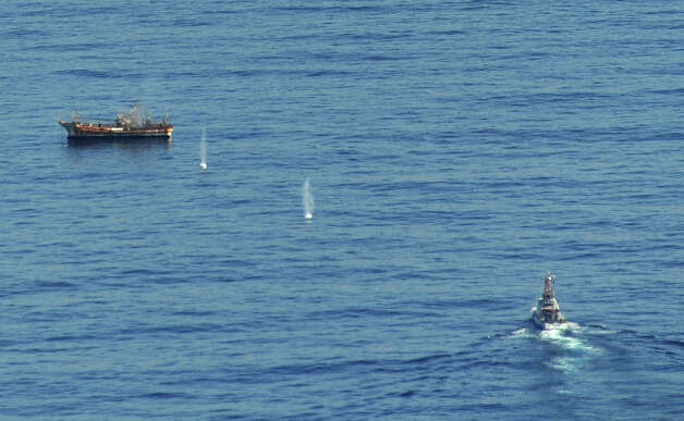 The Japanese fishing vessel Ryou-Un Maru is hit by the Coast Guard Cutter Anancapa crew firing explosive ammunition into it 180 miles west of the Southeast Alaskan coast April 5, 2012. The derelict fishing vessel sank at 6:15 p.m. in 6,000 feet of water. Photo: USCG / US COAST GUARD