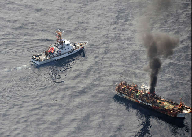 The Japanese fishing vessel Ryou-Un Maru is ablaze after being hit by the Coast Guard Cutter Anancapa crew firing explosive ammunition into it 180 miles west of the Southeast Alaskan coast April 5, 2012. The derelict fishing vessel sank at 6:15 p.m. in 6,000 feet of water. Photo: USCG / US COAST GUARD