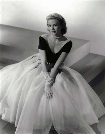 "A fashion icon in her own right, Grace Kelly stunned in a series of classy ensembles in ""Rear Window.""   (AP)"