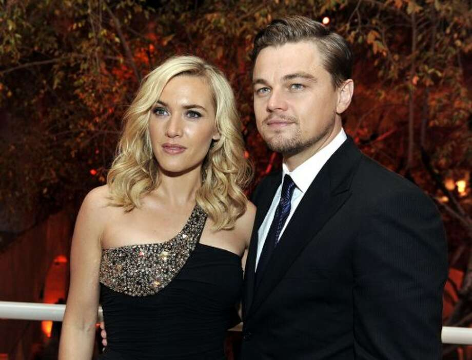 """Kate Winslet and Leonardo DiCaprio reunited for the suburban angst movie """"Revolutionary Road."""" They're pictured here in 2008. (Kevin Winter / Getty Images)"""