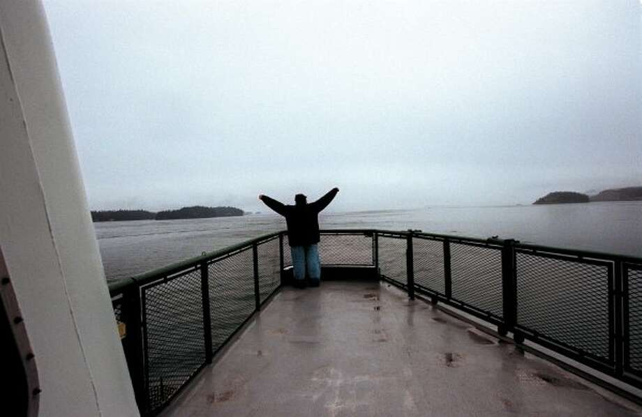 "...this pose on local ferries. Here's Katie McMillan, 17, of Hermiston, Oregon, doing ""I'm king of the world"" aboard the ferry Elwha to Sidney, B.C. (ROBIN LAYTON / Seattle Post-Intelligencer)"