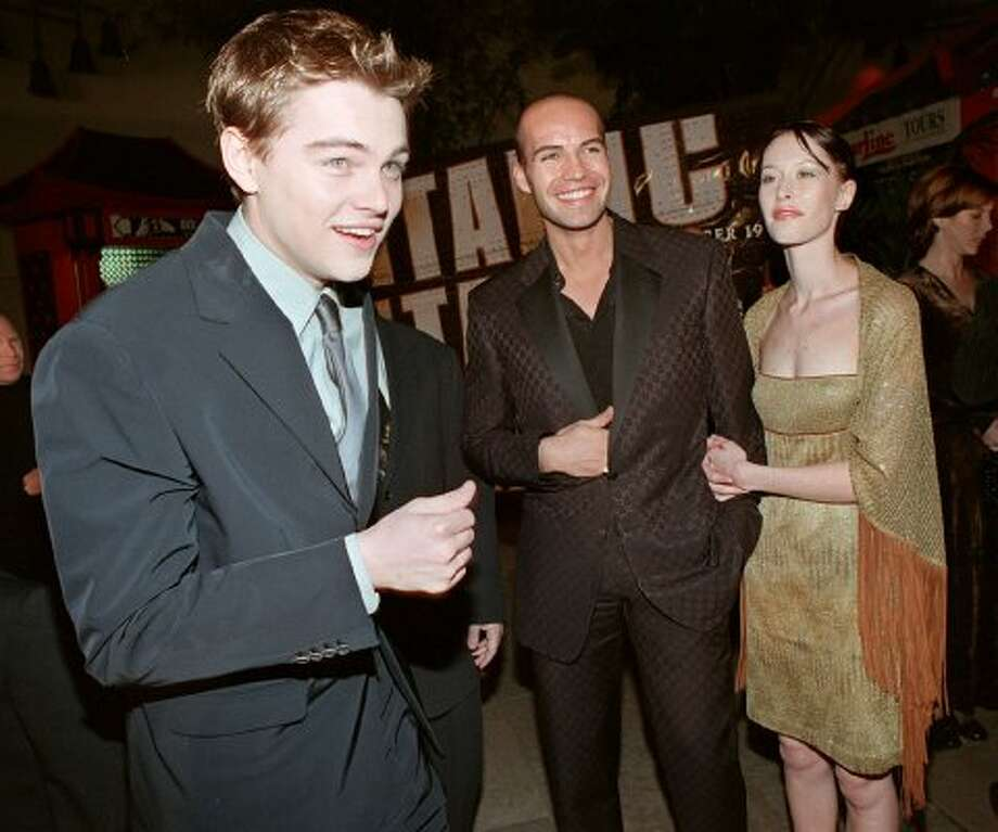 "So young. Here's Leonardo DiCaprio (L) and Billy Zane (C), who played Rose's mean fiance in ""Titanic,"" in 1997 at the movie's premiere. Zane is accompanied by girlfriend Jessica Murphy. (TIZIANA SORGE / AFP/Getty Images)"
