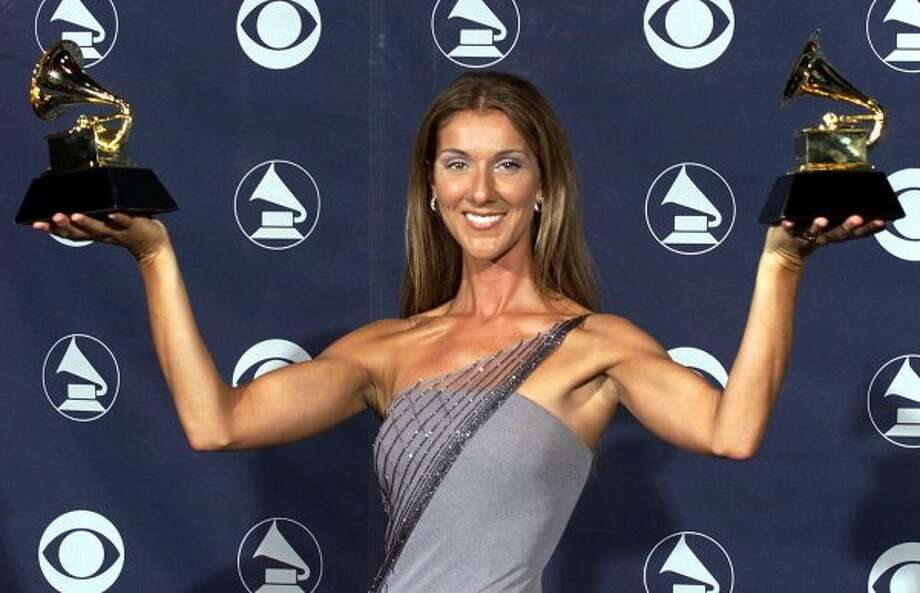 "Does the song ""My Heart Will Go On"" take you back to the 90s? How about Celine Dion thumping her chest with her well-toned arms while belting out that song? She's pictured posing with her 1998 Grammies, including one for that song.  (Vince Bucci / AFP/Getty Images)"