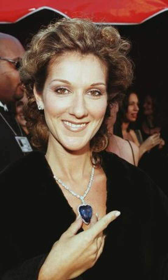The blue diamond! Celine Dion shows off a replica of the famous movie jewel at the Academy Awards in 1998. (Vince Bucci / AFP/Getty Images)