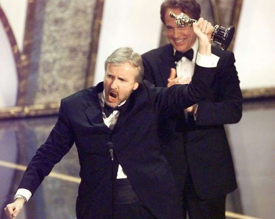 """I'm king of the world!"" shouted drector James Cameron after winning the Oscar for Best Director at the Academy Awards in 1998. The movie won a total of 11 Oscars. (TIMOTHY A. CLARY / AFP/Getty Images)"