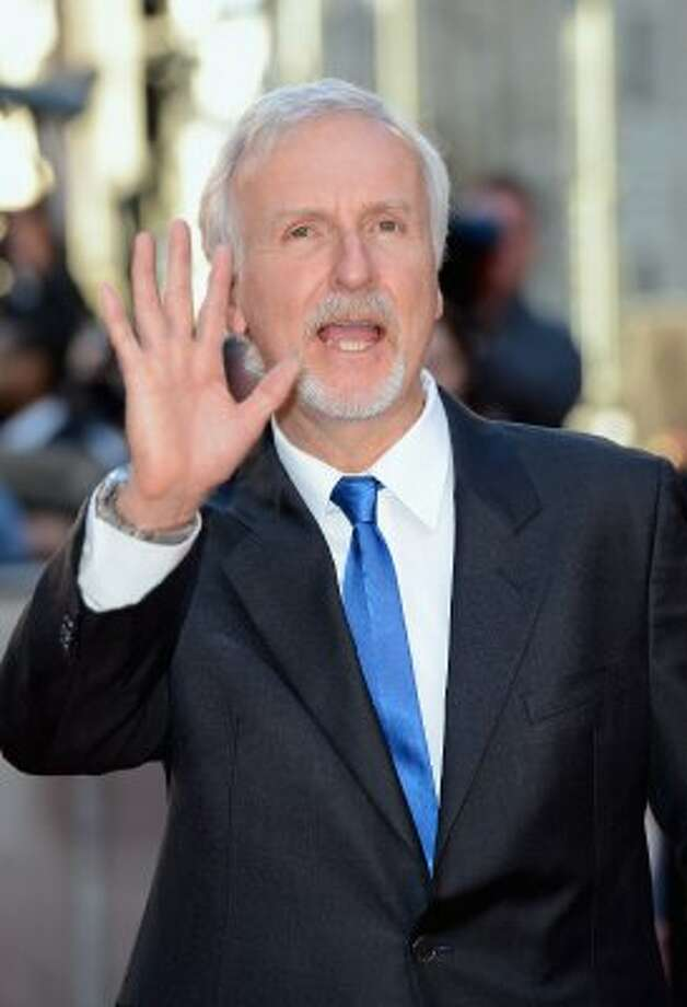 "Still waving. Here's James Cameron at the ""Titanic 3D"" premiere on March 27 in London. (Gareth Cattermole / Getty Images)"