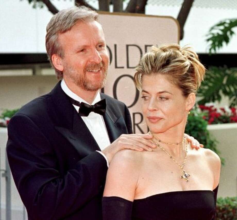 "Director James Cameron (L) and then wife Linda Hamilton at the Golden Globe Awards in 1998, when ""Titanic"" was nominated for eight honors. (HAL GARB / AFP/Getty Images)"
