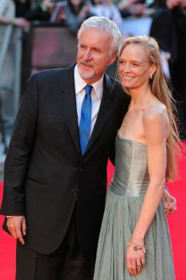 "James Cameron with current wife Suzy Amis, who appeared in ""Titanic,"" at the March 27 premiere of ""Titanic 3D"" in London. (CARL COURT / AFP/Getty Images)"