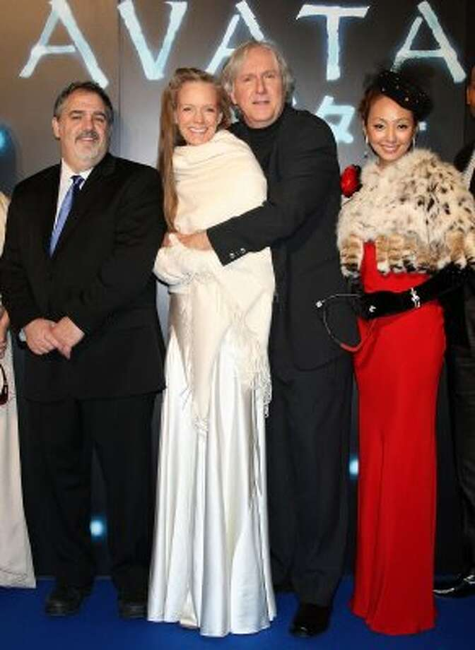 "In case you were worried that James Cameron isn't as huggy with new wife as he is with the old one, here's a 2009 picture of him and current wife Suzy Amis at the ""Avatar"" premiere in Japan. (Junko Kimura / Getty Images)"