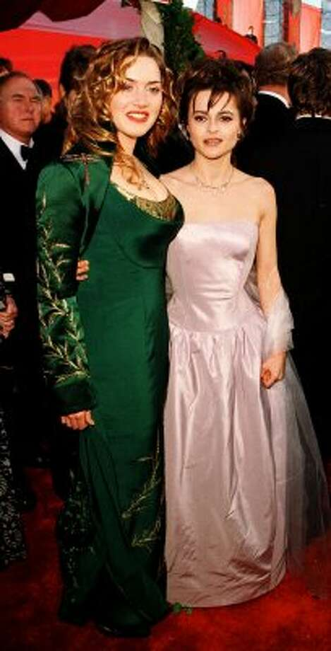 "One of the biggest things that's happened in Hollywood since the '90s? Better clothes and make-up. Here's Kate Winslet (L) at the 1998 Academy Awards, where she was nominated for ""Titanic."" She's pictured with Helena Bonham Carter, who was nominated for ""Wings Of The Dove."" (VINCE BUCCI / AFP/Getty Images)"