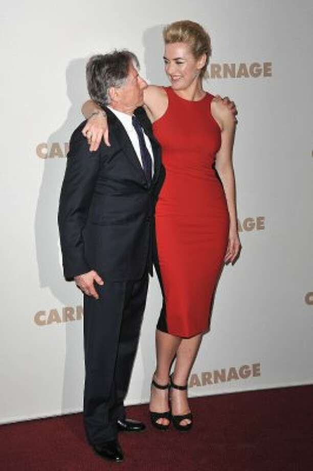 "And here's Kate Winslet in November of 2011, standing with Roman Polanski at the ""Carnage"" premiere in Paris. (Pascal Le Segretain / Getty Images)"