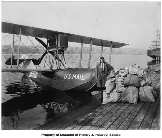 The B-1 mail plane was the first Boeing-designed commercial aircraft. It first flew on Dec. 27, 1919. Eddie Hubbard, pictured here, flew this one from 1920 to 1927 on the first regularly scheduled international air mail route between Seattle and Victoria, B.C. The plane could carry two passengers plus mail and cargo. After seven years of service without losing a single piece of mail, the B-1 was retired from air mail service in 1927. The plane now hangs on exhibit at the Museum of History & Industry, in Seattle. Photo: Museum Of History & Industry (image No. 1980.6877.176)
