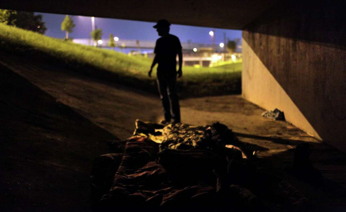 Gavin Rogers, Youth Minister at Trinity Baptist Church, spreads out his sleep pad under a bridge near I-10. Rogers gave up sleeping at home for Lent, to sleep with the Homeless on the streets. Thursday, April 5, 2012. Bob Owen/San Antonio Express-News.
