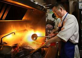 Head chef Xi Dong Yao preparing a dish on the wok stove at Old Mandarin Islamic restaurant, 3132 Vicente St., in San Francisco, California, on Wednesday, September 21, 2011.