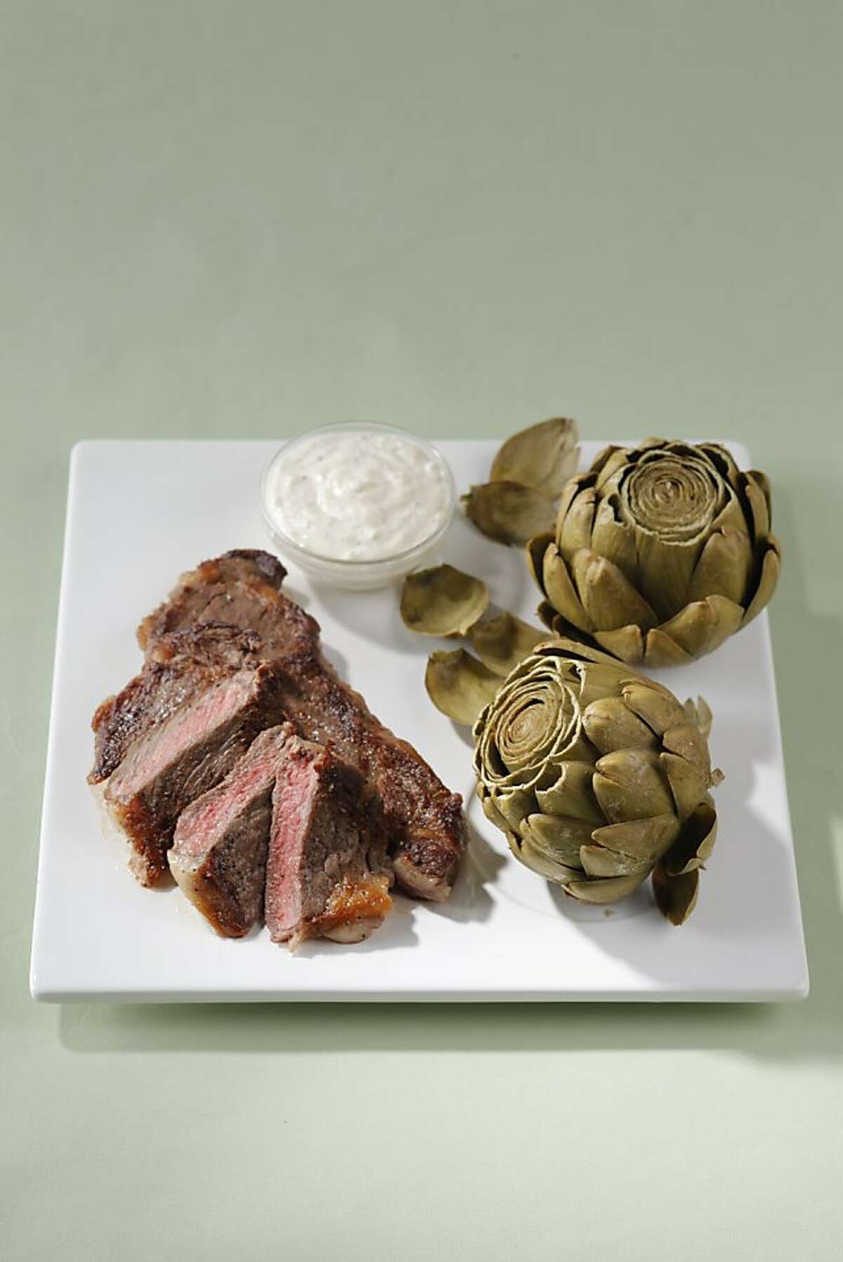 Steak and Artichoke with Spring Onion Aioli as seen in San Francisco on April 4, 2011. Food styled by Amanda Gold.