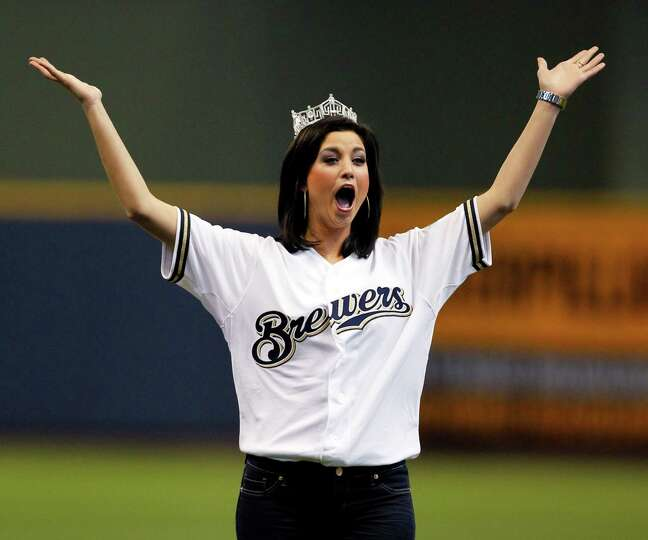 Miss America Laura Kaeppeler reacts after tossing out the ceremonial first pitch before an opening d
