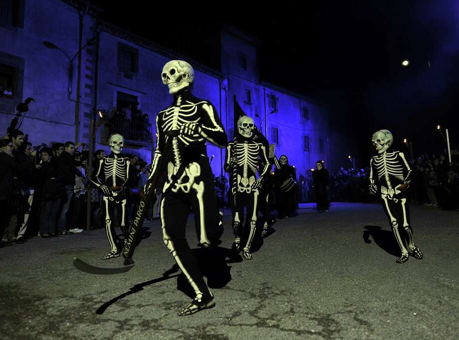 Dancers perform the Dance of the Death during a Holy Week procession in Verges, northeastern Spain, on April 5, 2012. Dancers dress in body stockings with sckeletons painted on them and carry symbols to stir the people and prepare them for a good death. Photo: LLUIS GENE, AFP/Getty Images / AFP