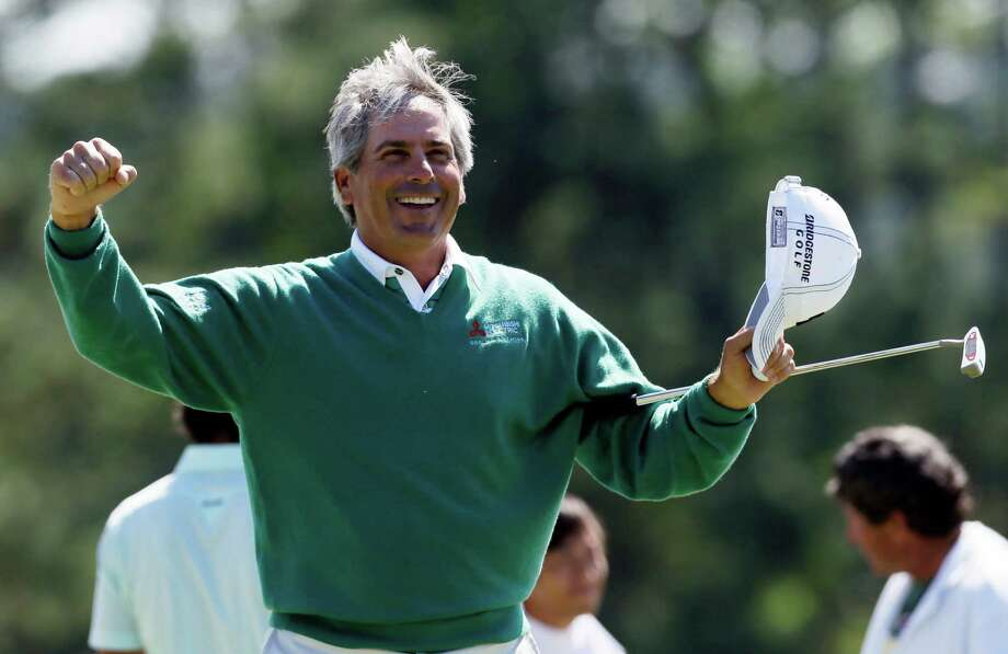 Fred Couples celebrates after finishing the second round the Masters golf tournament on the 18th hole Friday, April 6, 2012, in Augusta, Ga. Photo: AP