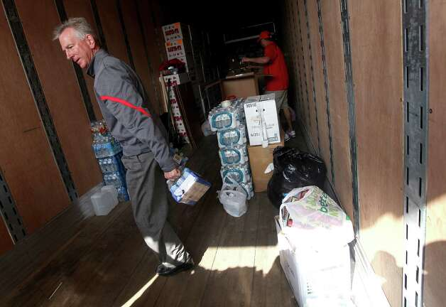 Texas Tech football coach Tommy Tuberville helps gather bound for the  Dallas-Fort Worth area after at least 15 tornadoes ravaged North Texas  on Tuesday. Tuberville and 30 of his players will travel from Lubbock on  Saturday to deliver the goods and help clean up. Photo: Zach Long, Lubbock Avalanche-Journal