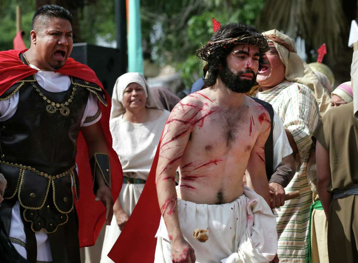 Jesus, played by Mario Jr. Mandujano, is yelled at during The Passion Play, a re-enactment of the suffering of Christ leading to his crucifixion in front of San Fernando Cathedral. Friday, April 6, 2012. Bob Owen/San Antonio Express-News.