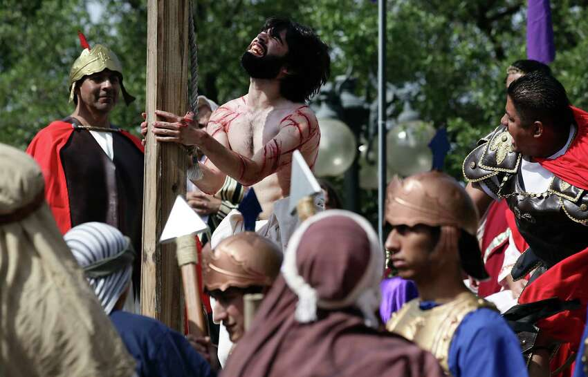 Jesus, played by Mario Jr. Mandujano, is whipped by a Roman soldier during The Passion Play, a re-enactment of the suffering of Christ leading to his crucifixion in front of San Fernando Cathedral. Friday, April 6, 2012. Bob Owen/San Antonio Express-News.