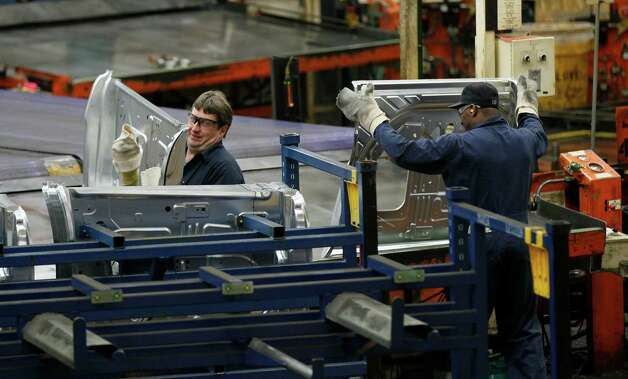 In this April 4, 2012 photo, auto workers at the Ford Stamping Plant stack the inner door panel for the Ford Explorer, in Chicago Heights, Ill. The Labor Department says the economy added 120,000 jobs in March, down from more than 200,000 in each of the previous three months. Manufacturers added 37,000 jobs. (AP Photo/Charles Rex Arbogast) Photo: Charles Rex Arbogast