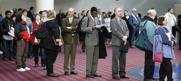 FILE - In this March 7, 2012, file photo shows job seekers standing line during the Career Expo job fair, in Portland, Ore.  Employers pulled back sharply on hiring last month, a reminder that the U.S. economy may not be growing fast enough to sustain robust job growth. The unemployment rate dipped, but mostly because more Americans stopped looking for work.  The Labor Department says the economy added 120,000 jobs in March, down from more than 200,000 in each of the previous three months. (AP Photo/Rick Bowmer) Photo: Rick Bowmer
