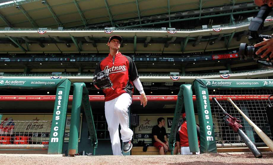 Houston Astros center fielder Jordan Schafer (1) emerges onto the field during batting practice before the start of the Astros season opener at Minute Maid Park on Friday, April 6, 2012, in Houston. Photo: Karen Warren, Houston Chronicle / © 2012  Houston Chronicle
