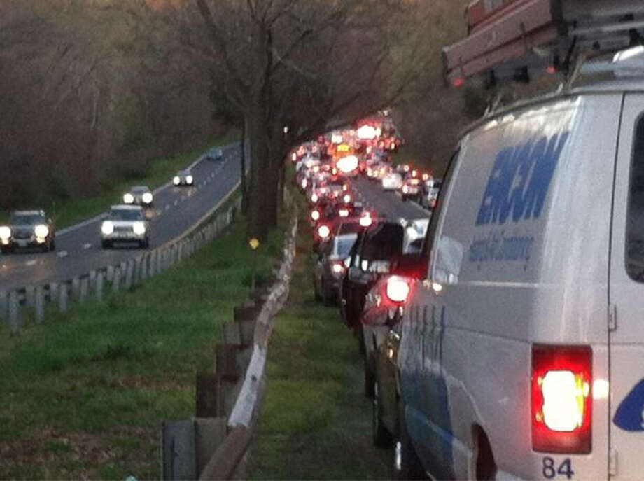 Traffic on the Merritt Parkway sits at a standstill following an accident Friday evening between extis 35 and 36 northbound. Photo: Contributed Photo