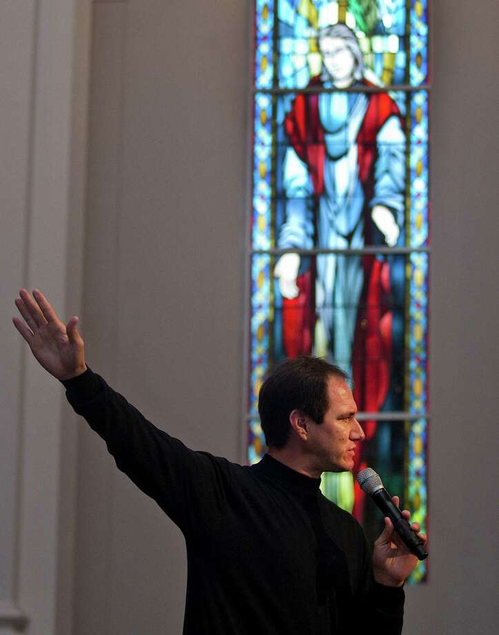Alfonso Gilbert addressed his new church during last Sunday's service at Second Baptist. Gilbert, a California native, was hired to lead  the church's new Spanish-language services. Photo: J. Patric Schneider / Houston Chronicle