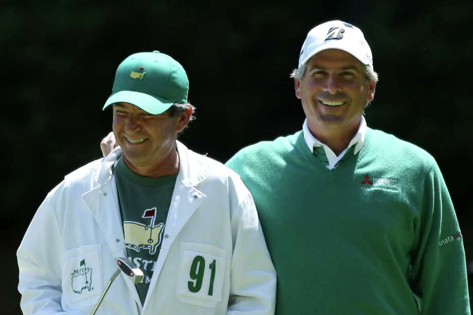 AUGUSTA, GA - APRIL 06:  Fred Couples of the United States and his caddie David Kerr walk on the 13th green during the second round of the 2012 Masters Tournament at Augusta National Golf Club on April 6, 2012 in Augusta, Georgia.  (Photo by Andrew Redington/Getty Images) Photo: Andrew Redington / 2012 Getty Images
