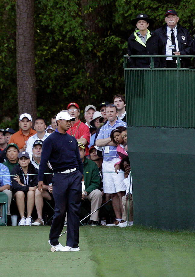 Tiger Woods reacts to his tee shot on the 16th hole during the second round of the Masters golf tournament Friday, April 6, 2012, in Augusta, Ga. Photo: Matt Slocum