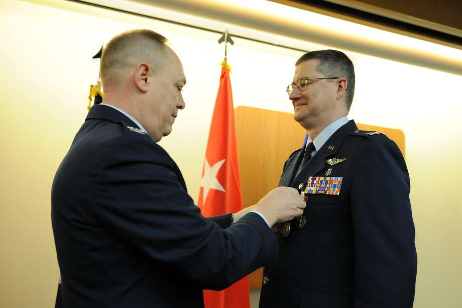 Division of Military and Naval Affairs Air National Guard Col. Reid Muller receives a New York Conspicuous Service Medal from Col. Kevin Bradley during Muler?s retirement testimony in Syracuse.