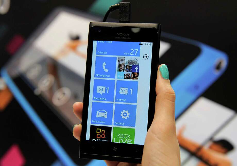 The sleek Lumia 900 is zippy and has good battery life. It offers plenty of bang for the buck, but there's not much depth in the app selection. Photo: LLUIS GENE / AFP