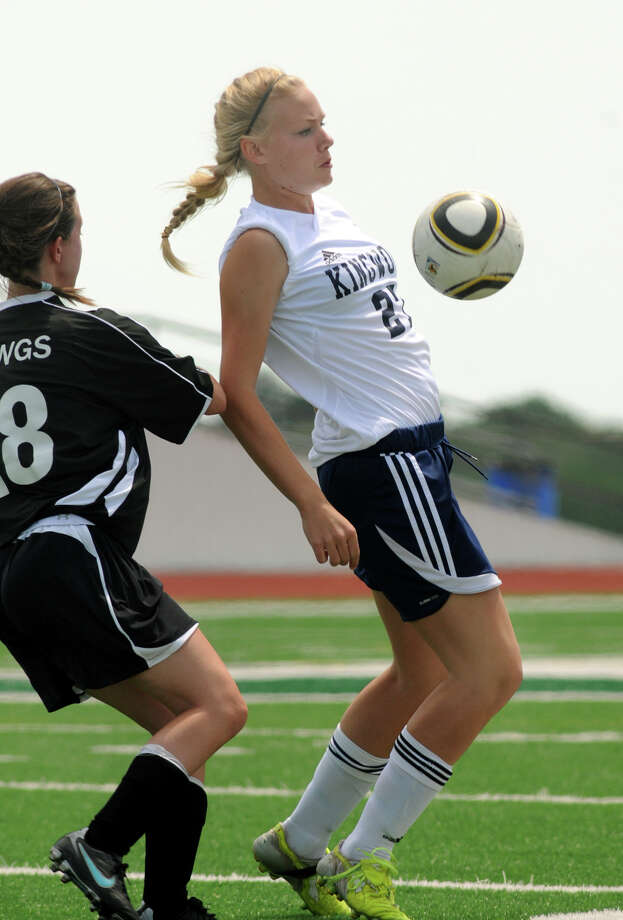 Kingwood sophomore defender Brooke Brady controls the ball in front of Austin Bowie junior forward Amanda Marquette during first period action of their Region II-5A Area Playoff at Brenham Cub Stadium on Friday. Freelance photo by Jerry Baker Photo: Jerry Baker, For The Chronicle