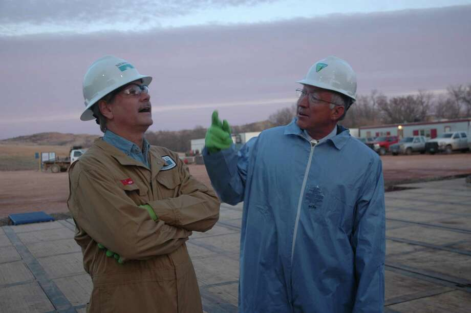 Sen. John Hoeven, R-N.D., and Interior Secretary Ken Salazar talk about the North Dakota oil boom after visiting a rig drilling the first of two wells in the state for Newfield Exploration Co. Although the site is private land, it will drain oil from subsurface territory owned by the government. Photo: Jennifer A. Dlouhy